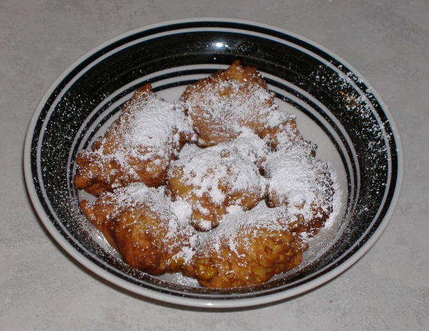 Photo of Crispy Corn Fritters covered in powdered sugar and ready to ...
